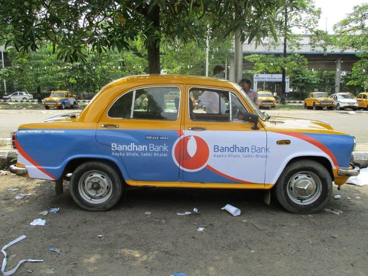 Bandhan Bank launches in Kolkata, and Ideazfirst uses the extensive taxi network to paint their brand on the taxis...in association with Madison - MOMS