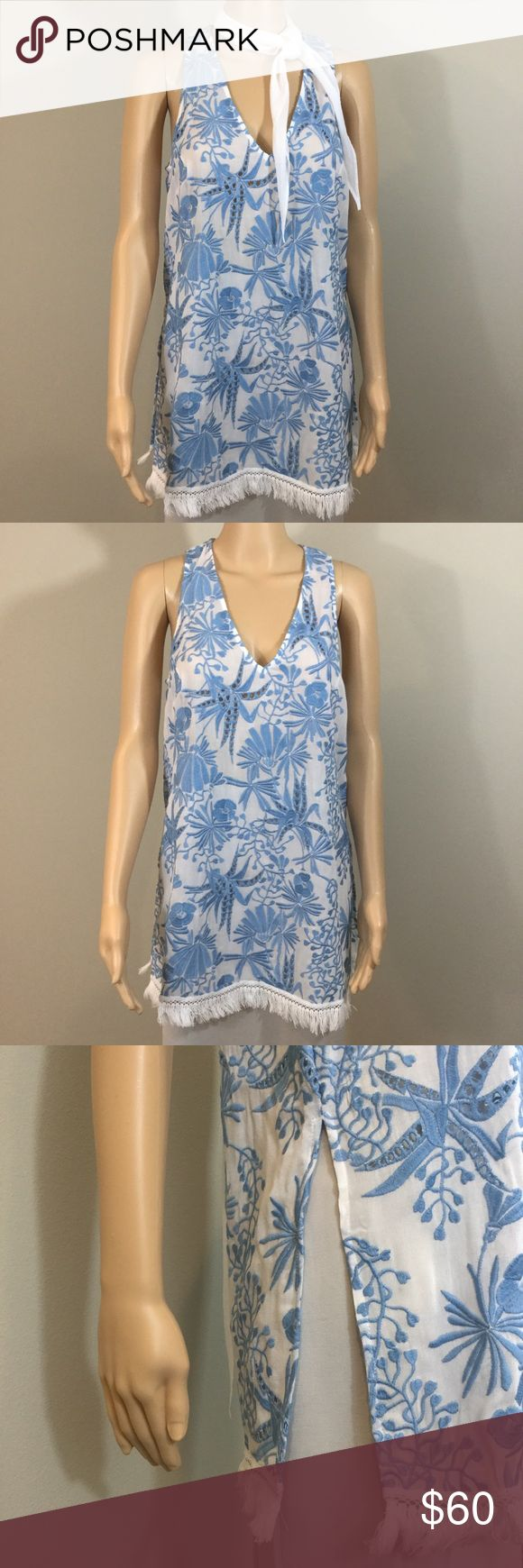 Fifteen Twenty Light Blue Embroidered Tunic Fifteen Twenty light blue embroidered sleeveless tunic with pom poms along the bottom and slits along the sides. New with tags, never worn. Fifteen Twenty Tops Tunics