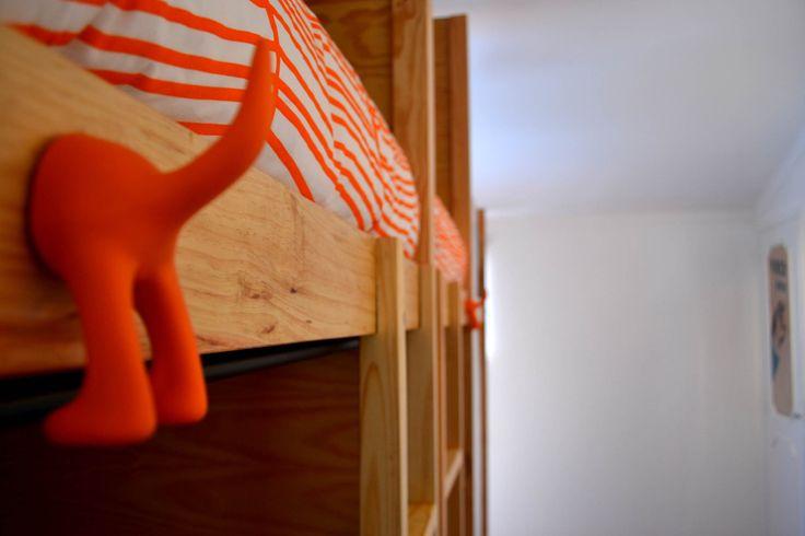 Details; Beds; Shared Dorms; Bunk beds; Orange; Sun & Sea.