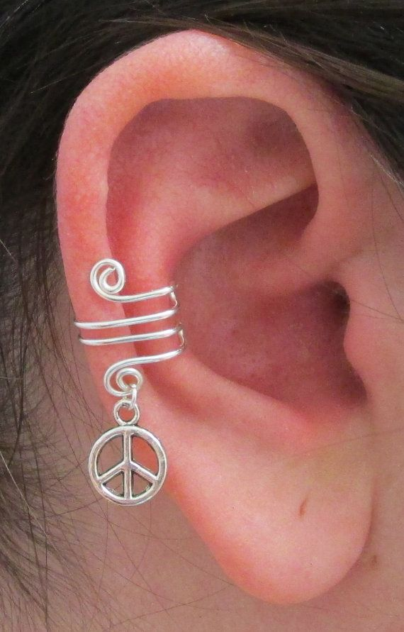 This spiral wire ear wrap is made with non tarnish silver plated artistic wire and has a lead-free pewter Peace Signcharm dangling from it.   No piercing required to add a little bit of sparkle to your outfit! Great for a birthday gift, graduation gift, or a just because gift!  $5.25