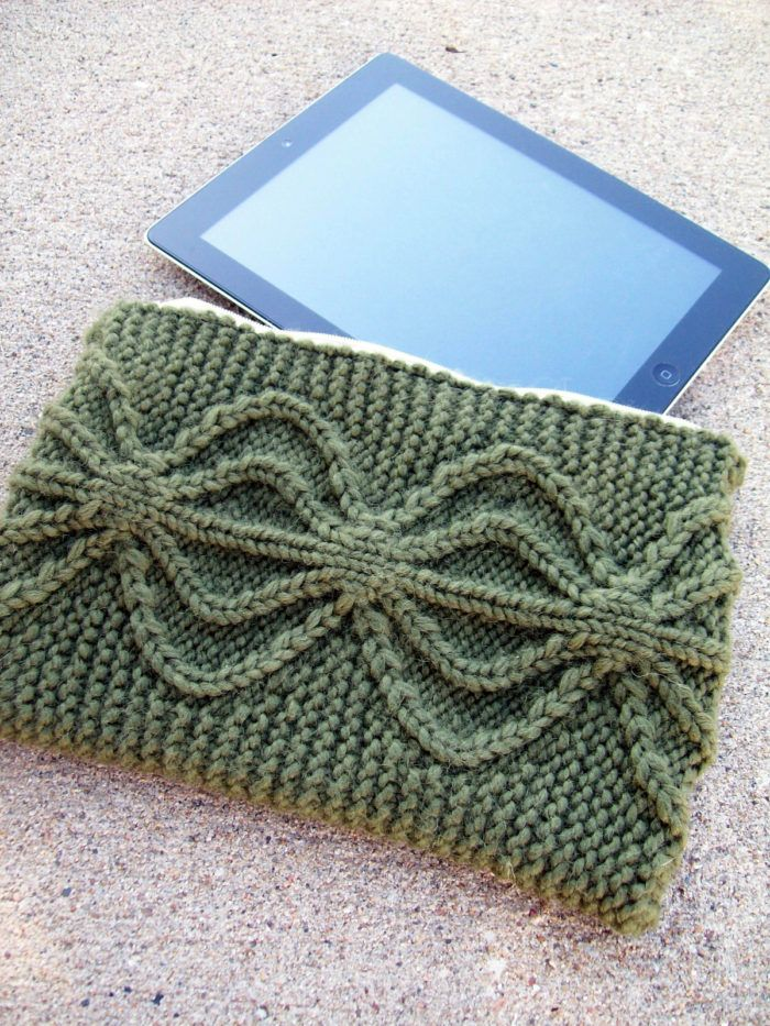 Knitting Pattern for Aviatrix Clutch or Tablet Cover - This clutch features a bold birdcage cable on a background of garter stitch. 2 sizes 6 x 9 inches and 8 x 11 inches. Quick knit in bulky yarn. Designed by Sarah Wilson