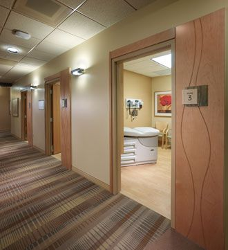 The diagnostic and treatment corridors have maple wood panels surrounding each exam room door. Throughout, the textures and color of the desert have been woven into the healthcare design concept, including signage.