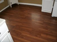 Pergo laminate snap fix 10 MM flooring. Cherry Walnut color. Kitchen flooring ideas and designs
