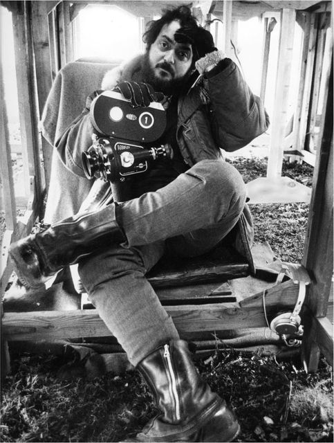 Stanley Kubrick, holding an Arriflex film camera, waiting for the rain to stop on shooting A Clockwork Orange.