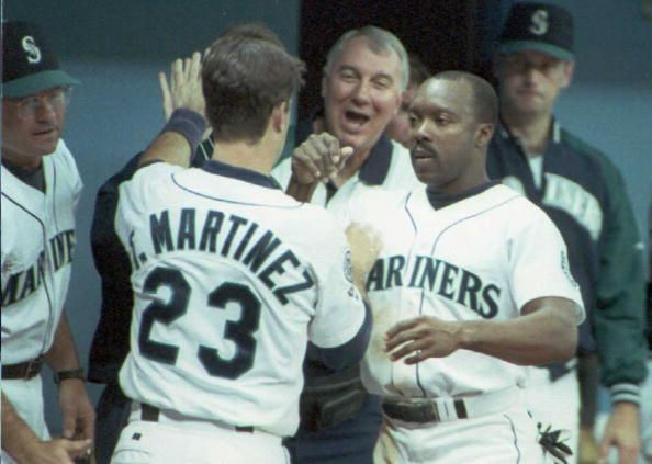 Tino Martinez of the Seattle Mariners is congratulated by teammate Vince Coleman after scoring a run in sixth inning of their 06 October playoff game...
