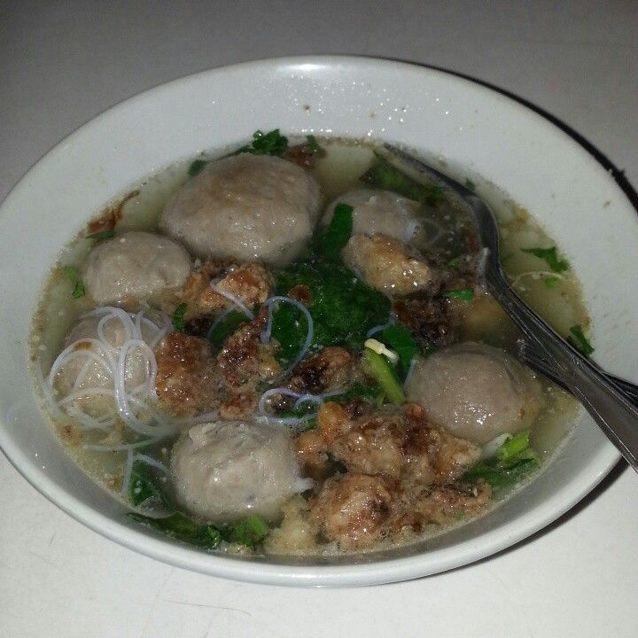 Meat ball with crispy meat,vegetables and noodles try it if you go to indonesia