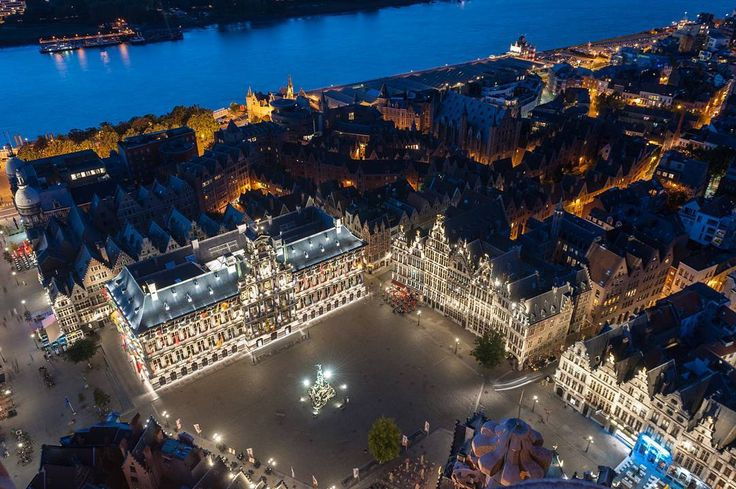 """antwerpen A bird's-eye view of our """"Grote Markt"""" and City Hall. It was designed by Cornelis Floris De Vriendt, in mostly Renaissance style but the middle part has Baroque features. Isn't she a beauty? ©www.woodmonkey.be #visitantwerp #antwerpen #antwerp #anvers #amberes #city #travel #tourism #beautiful #cityhall #picoftheday"""