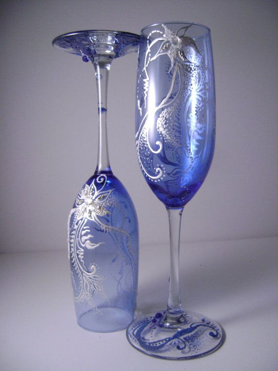 WOW looking Wedding champagne glasses in royal blue and pearl, perfect for your winter wedding or as a Christmas eve table glassware on Etsy, $64.00