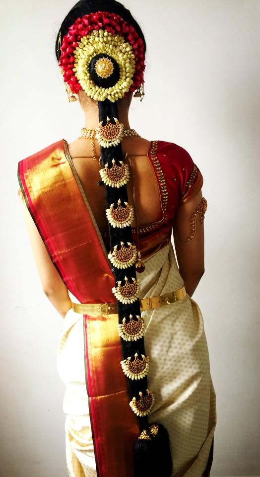 South Indian bride. Temple jewelry. Jhumkis.Red silk kanchipuram sari.Bun with fresh flowers. Tamil bride. Telugu bride. Kannada bride. Hindu bride. Malayalee bride.Kerala bride.