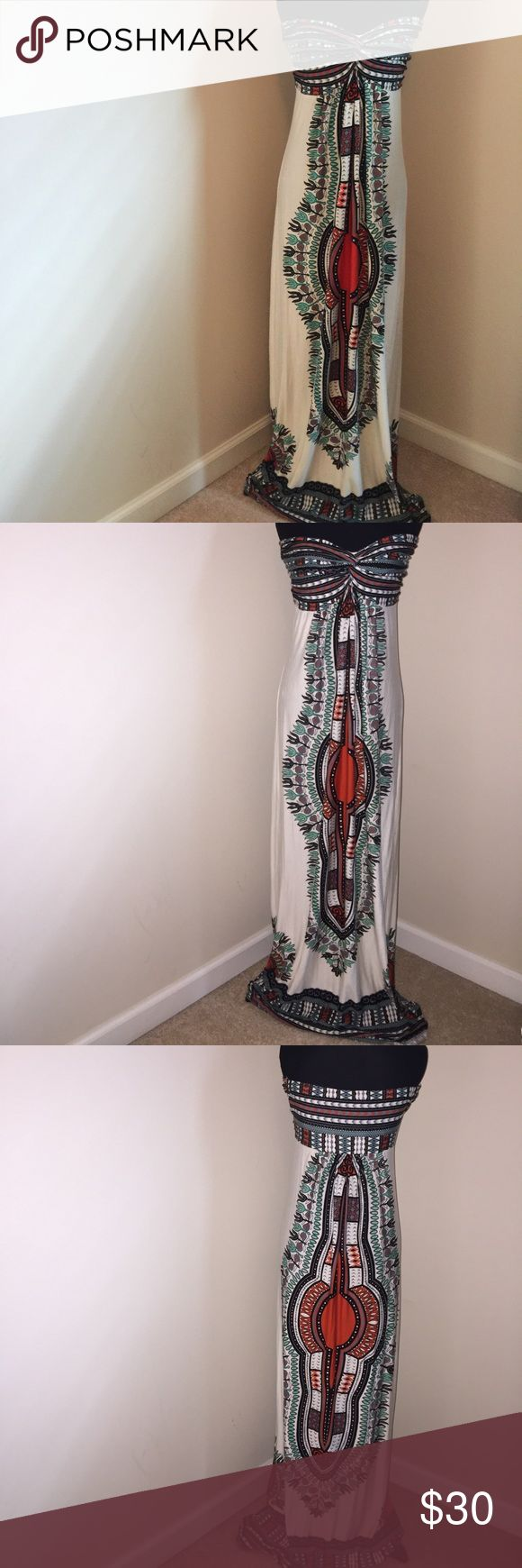 Aztec Maxi Dress Never worn tags still attached Aztec maxi dress. Smoke free home in perfect condition. This dress is sleeveless and floor length Angie Dresses Maxi