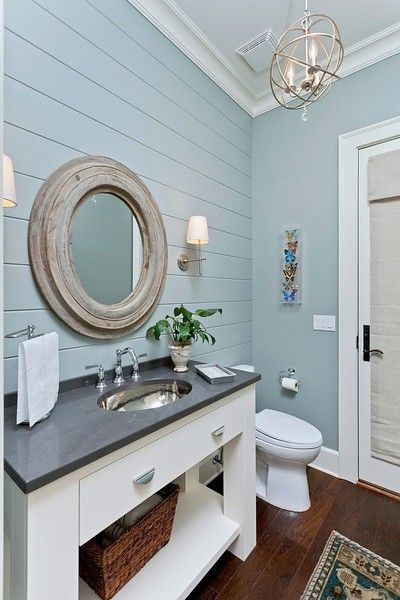 blue grey paneled wall white mirror