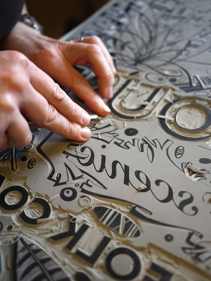 Angie Lewin cutting one of the blocks for her 'Salthouse' limited edition one-off linocut for Coast magazine http://allthingsconsidered.co.uk/2010/04/angie-lewins-salthouse-poster.html