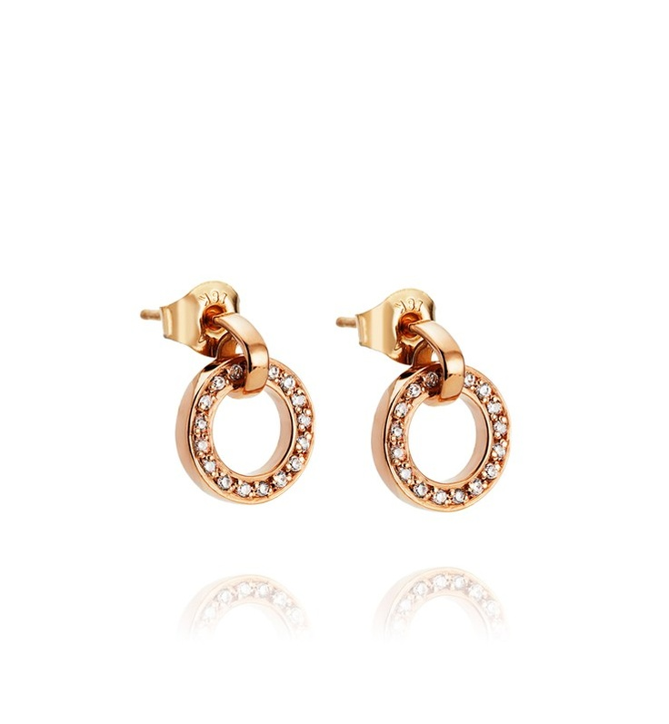 Efva Attling - The Ring Earrings - $2,280. Gold earrings, with movable ring set with diamond.