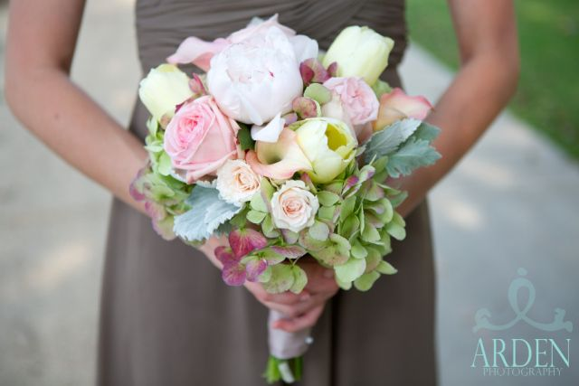 Meredith's bridesmaids carried clutch bouquets of blush and green flowers including antique green hydrangea, French tulips, white peonies, b...