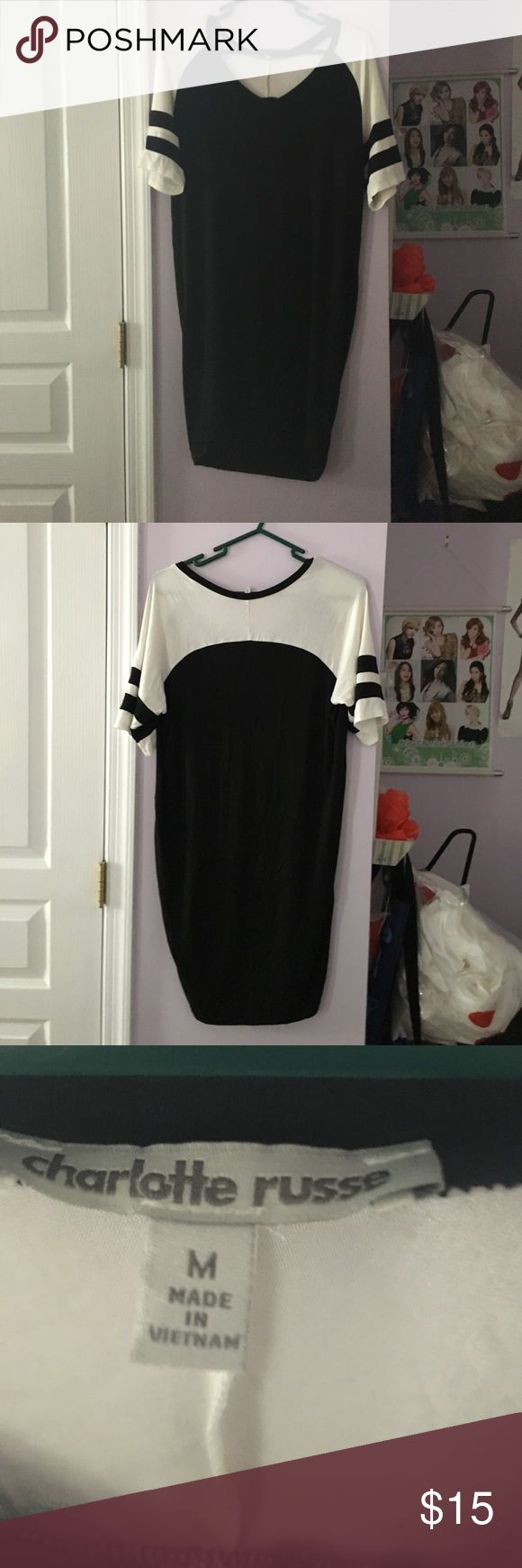 Black and white sporty dress It's has been gently used and is in great condition. The fabric is soft and stretch. Can also fit anyone who is a size large. Any questions leave them down below and I will get back to you as soon as possible. Charlotte Russe Dresses Mini