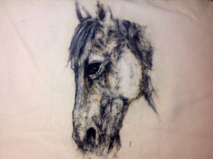 Needle felted to woolfabrick. Riada art