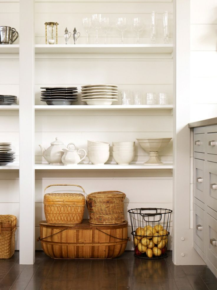 Put picnic baskets in the sitting room, underneath the low shelves? Or even the crates full of silver?