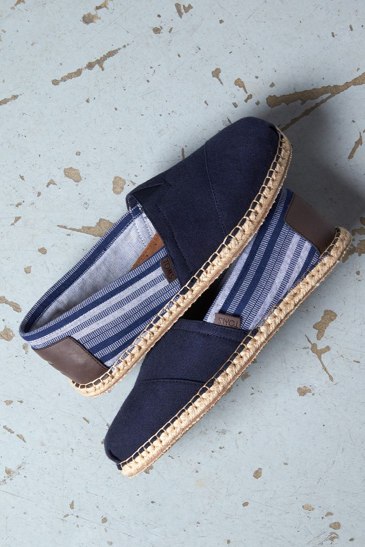 Featuring an espadrille-inspired rope sole, these navy striped hemp TOMS Classics slip-on shoes are sure to be a summer favorite for the guys.