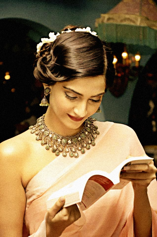 I love the idea of rustic, bold statement necklaces with soft and sweet sarees. Sonam Kapoor reading.