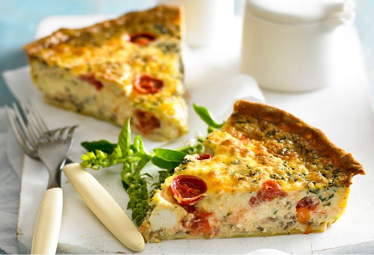 This moreish quiche is spiked with chunks of feta and cherry tomatoes.