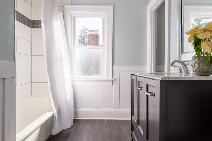 Love the white wainscoting and large white subway tile. Benjamin Moore Pale Smoke paint.