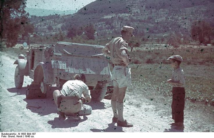 photo german soldiers speaking   sicilian boy   changed  tire   kuebelwagen