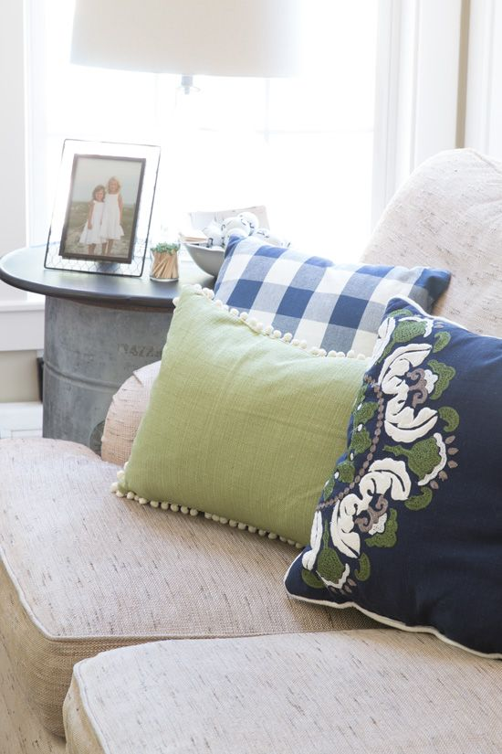 A Green and Navy Family Room decorated for Summer with a Gorgeous Pillow Collection!