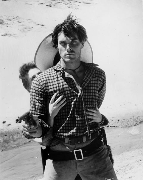 Jeffrey Hunter (with Natalie Wood behind him) in The Searchers, directed by John Ford, 1956. >>> To watch this movie is to fall in love with Jeffrey Hunter.