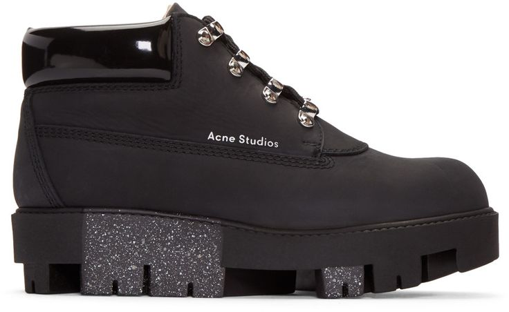 Ankle-high nubuck calfskin boots in black. Round toe. Tonal lace-up closure with mock hook fastenings. Padded tongue. Logo stamp in silver-tone at outer side. Padded patent leather collar. Treaded foam rubber sole in black featuring paint splatter effect. Alternate lacing in beige. Silver-tone hardware. Tonal stitching.