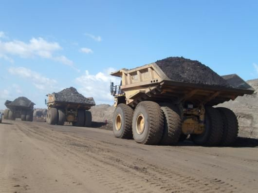 Tar Sands Art: Photograph of huge tar sands mining trucks in Alberta, Canada. Each one of these trucks carries 400 TONS of sand (aka bitumen) extracted from the soil. the tar is extracted from the bitumen. #tarsandsart