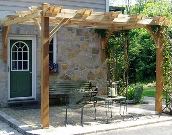 patio deck with pergola grapevine arbor ideas sun protection outdoor furniture
