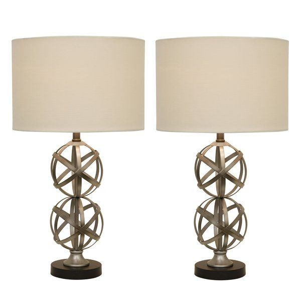 Instantly add depth and dimension to your home by adding the 2 Piece Table Lamp Set to your living space. This set of 2 transitional table lamps feature a steel base with two chic orbs- making this set one that is packed with design and texture. Paired with a round drum shade for a classic feel.