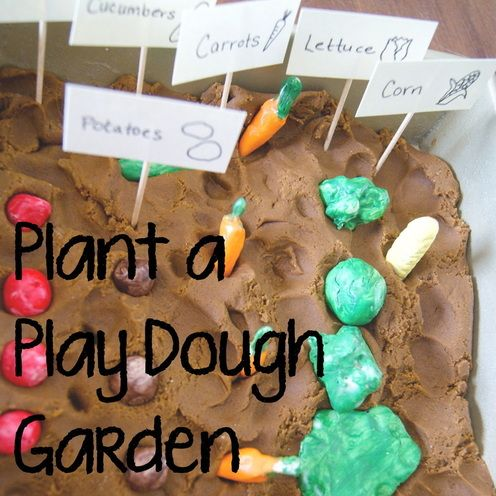 Make vegetables with Sculpey or Fimo, bake and paint them, coat them with mod podge and then plant them in brown playdough!