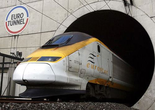 The Channel Tunnel is a 50.5-kilometre (31.4 mi) undersea rail tunnel linking Folkestone, Kent, in the United Kingdom with Coquelles, Pas-de-Calais, near Calais in northern France beneath the English Channel at the Strait of Dover.