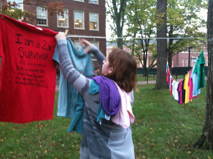 A student takes hangs t-shirts made for #theclotheslineproject which raises awareness on the violence against women #MiamiOH