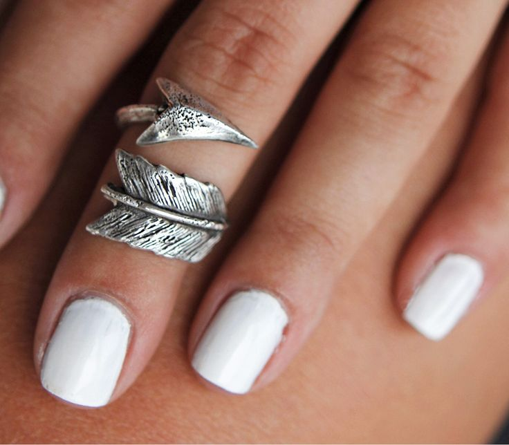 Boho Jewelry, Sterling Silver Midi Ring: An sterling silver arrow wraps around any part of your finger for a cool carefree boho chic allure. It's sporadically pitted for a well-worn look and then the