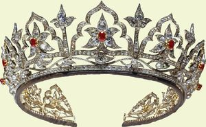 """Queen Victoria's State Jewelry: """"The Oriental Circlet,"""" 1853. Diamonds, rubies, gold. The inspiration for the design of this tiara, which includes 'Moghul' arches framing lotus flowers, came from Prince Albert who had been greatly impressed by the Indian jewels presented to the Queen by the East India Company. It was originally set with opals which were Prince Albert's favorite stone. It was later altered by Queen Alexandra and reset with rubies."""