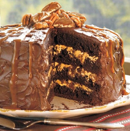 Classic Southern Chocolate Turtle Cake Recipe ~ Says: A simple sweet caramel filling and turtle candies sandwiched between fudgy brownielike cake layers and frosted with dark chocolate come together in this ultimate dessert splurge