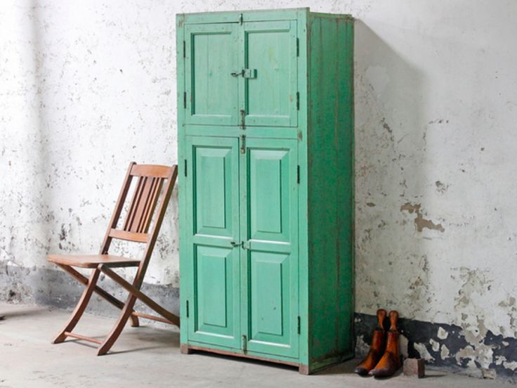 An iconic large vintage green wardrobe with shelves cabinet with a pair of panelled doors. #wardrobe #vintage #homedecor #homestyle #kitchenideas #bedroomideas #sale