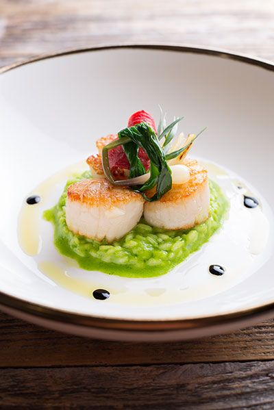 At Bellamy's in Escondido, French Master Chef Patrick Ponsaty offers California modern cuisine with French influences. With the help of his Diver Maine Scallops recipe served with a kale-parsley risotto and topped with a confit tomato, you, too, can cook like a French chef in your own home.