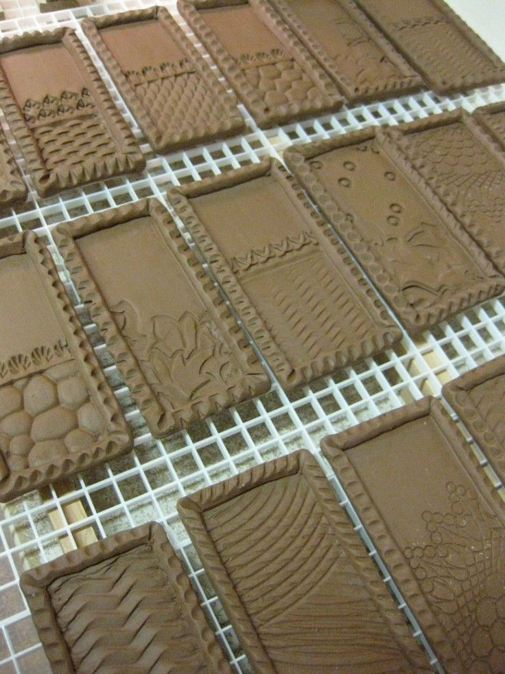 Cut rectangle slabs, then flat or coil borders with textures? Super simple with great results.