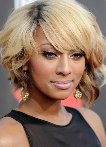 Short Wavy Hairstyle with Side-swept Bangs