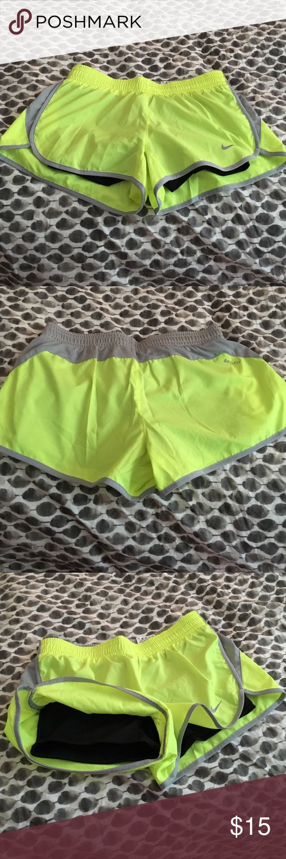 Neon Yellow Nike Shorts Neon yellow and gray Nike women's workout shorts with black spandex shorts built in. Dri fit size small. Worn once. Nike Shorts