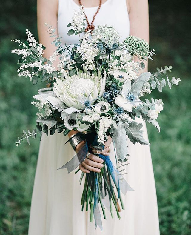 Pretty #bouquet full of white proteas, thistle, queen anne's lace, anemones…