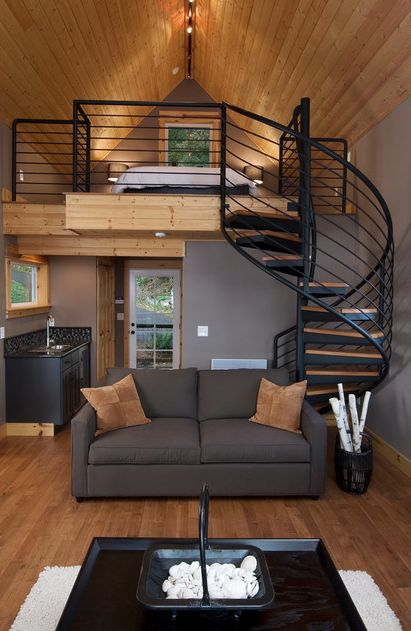 #tumbleweed #tinyhouses #tinyhome #tinyhouseplans Olympia Eld Inlet Cabin Remodel and Studio Addition. A lovely loft with that beautiful ironwork and curved stairs. | Tiny Homes