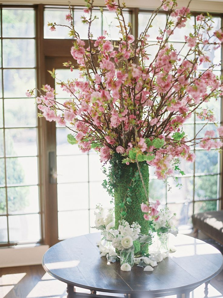 Cherry Blossom Centerpiece -- ahhh Spring!! On http://www.StyleMePretty.com/2014/03/31/celebrity-stylists-wedding-at-bedford-post-inn/ Trent & Dara Of Trent Bailey Photography - www.trentbailey.com on #SMP