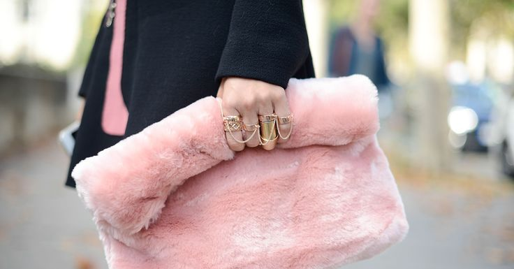 A Topshop handbag looked totally luxe clutched by a set of gold rings. Paris fashion week spring 2015
