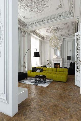 Mélange des univers, style ancien avec moulure et parquet dalle de versailles. canapé art déco vert
