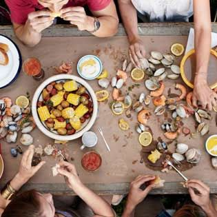 Throw a Backyard Clambake - cover the table with heavy paper or several layers of newspaper  - when you are finished eating roll up the mess and throw it all away.