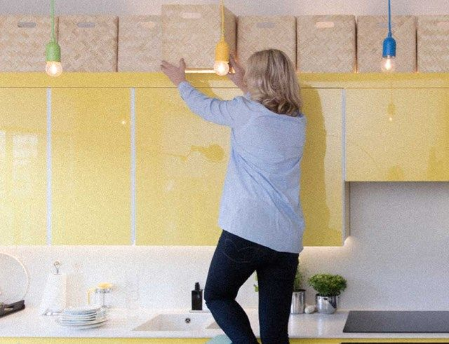 Tiny Kitchens Tour - Brought to you by Finish - Baskets on top of the cupboards! clever idea and much neater!